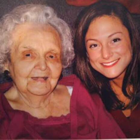 A woman with an elderly woman smiling at the camera