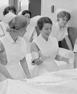historic image of nurses at bedside