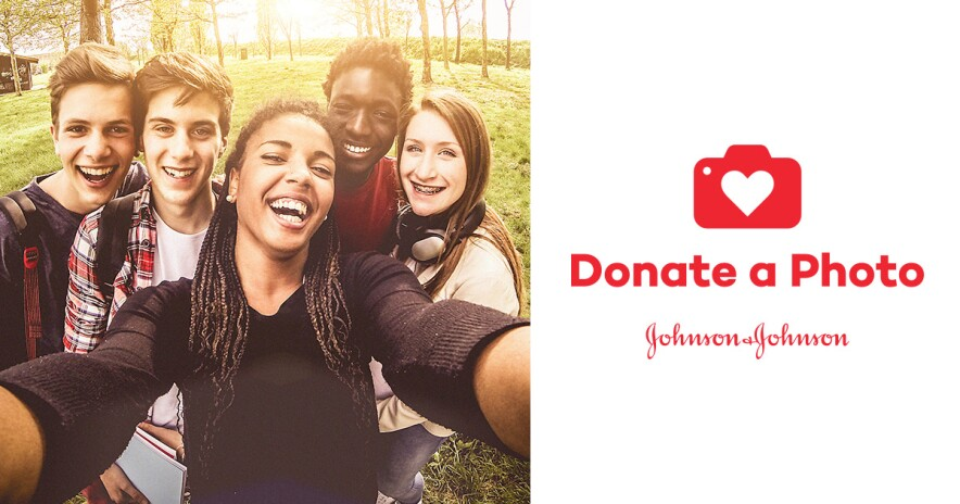 A group of teens smiling and taking a selfie for Donate a Photo