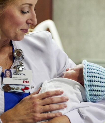 Close-up of female nurse holding newborn baby
