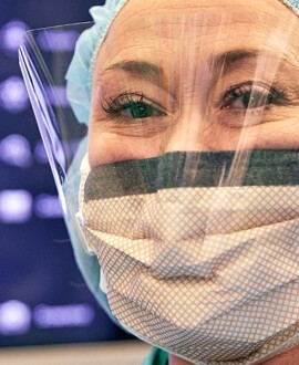 image of nurse wearing mask and face shield