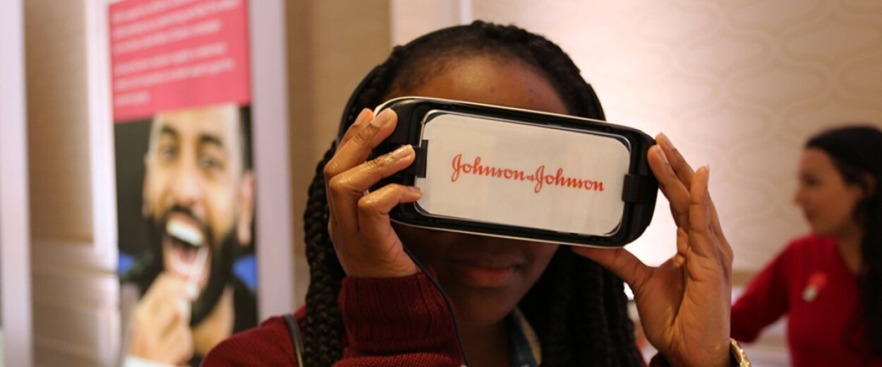 Woman looking through a Johnson and Johnson VR device