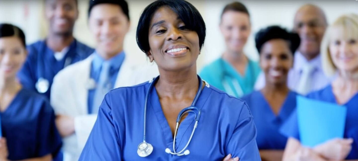 A group of nurses and healthcare professionals smiling