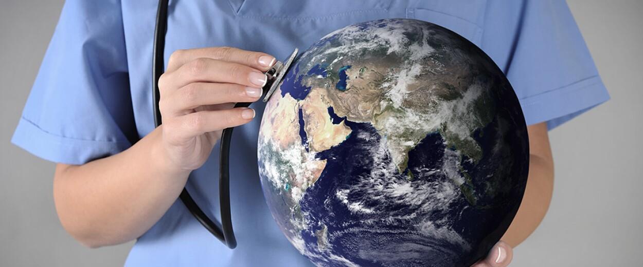 Image of nurse putting stethoscope up to globe