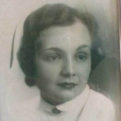 Black and white picture of female nurse from decades ago